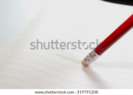 Eraser on paper, for filling posts. - stock photo