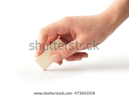 Eraser tool in a hand , isolated on white