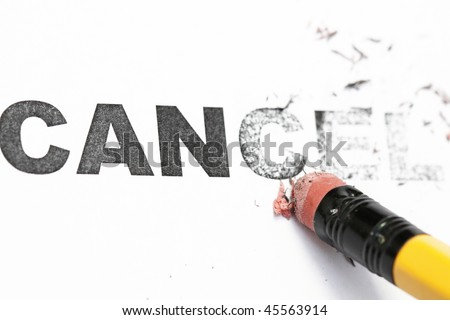 Erasing Cancel in a white background concept. - stock photo