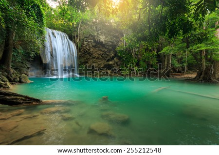 Erawan Waterfall, beautiful waterfall with sunlight rays in deep forest, Erawan National Park in Kanchanaburi, Thailand