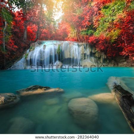 Erawan Waterfall, beautiful waterfall with sunlight rays in deep forest, Erawan National Park in Kanchanaburi, Thailand - stock photo