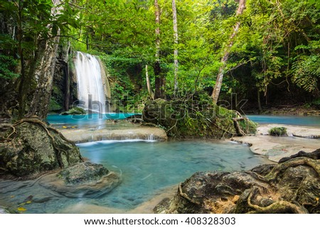 Erawan waterfall environment with big tree and emerald water in Kanchanaburi, Thailand