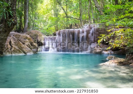 Erawan waterfall 5th level famous attraction of Kanjanaburi province in Thailand. - stock photo