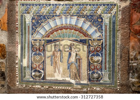 ERCOLANO, ITALY-JUNE 24, 2015: colorful villa mosaic between the ruins of the Roman Emperor's town of Ercolano preserved after the eruption of the Vesuvio volcano on 79dc, in Ercolano.