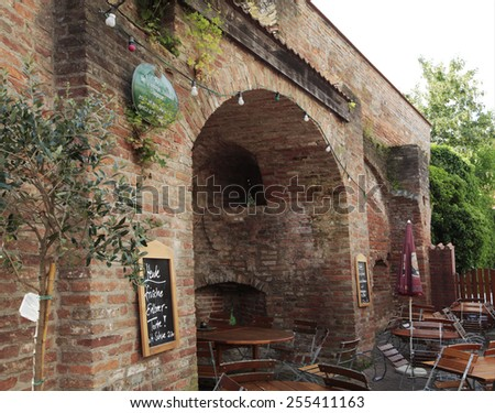 ERDING, GERMANY - JUNE 21, 2013:  Behind the remains of the old Erding town wall is a idyllic Beergarden patio. Erding is famous from the Erdinger beer.