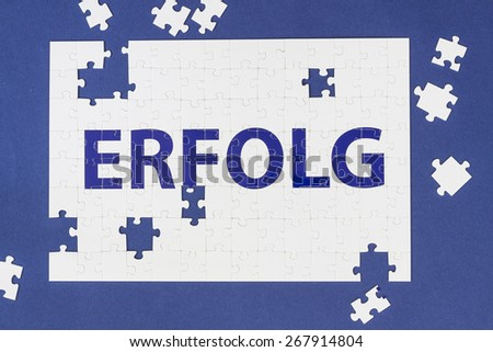 Erfolg - success in german, puzzle - stock photo