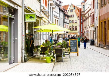 ERFURT, GERMANY  - JUN 16, 2014:  Small street of the city of Erfurt, Germany. Erfurt is the Capital of Thuringia and the city was first mentioned in 742