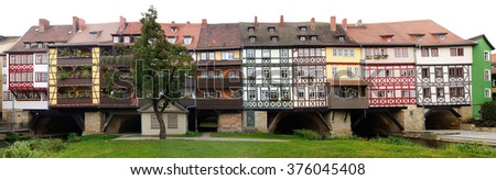 ERFURT, GERMANY - SEPTEMBER 24, 2012: Merchants' Bridge. Bridge was built in 1325. The only bridge north of the Alps to be built over entirely with houses;  - stock photo