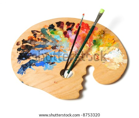 Ergonomic artist's palette with brushes isolated over a white background - stock photo