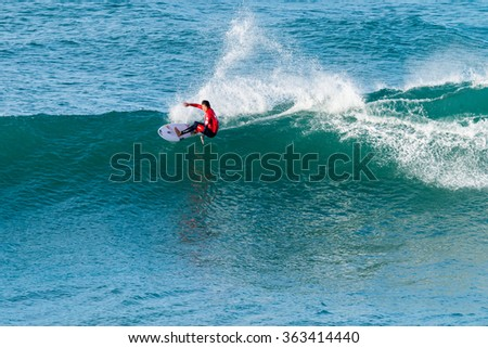 ERICEIRA, PORTUGAL - JANUARY 13, 2015: Kanoa Igarashi (USA) during the 2016 World Junior Championships, Men's Junior Tour #1 at Ribeira D'Ilhas beach - Ericeira, Portugal.