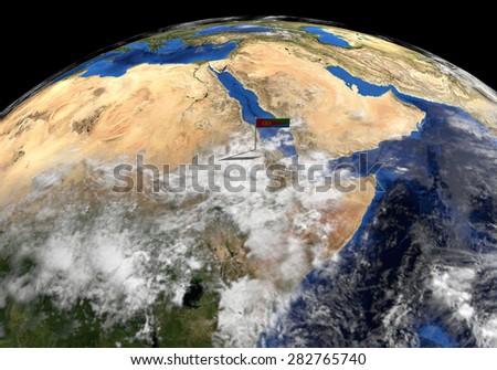 Eritrea flag on pole on earth globe illustration - Elements of this image furnished by NASA - stock photo