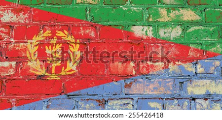 Eritrea flag painted on old brick wall texture background - stock photo