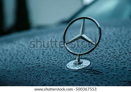 Erkrath, Germany - 11.02.13: Mercedes-benz hood emblem on a cloudy and rainy day.
