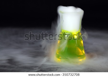 Erlenmeyer flask with a fog of dry ice. - stock photo
