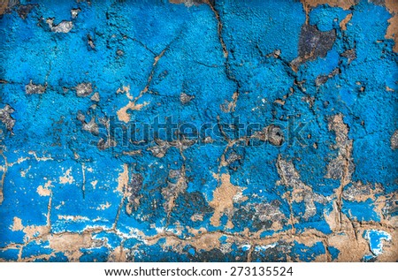 Eroded blue paint on a concrete wall background. - stock photo