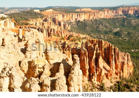 eroded hillside of orange hoodoo rock formations