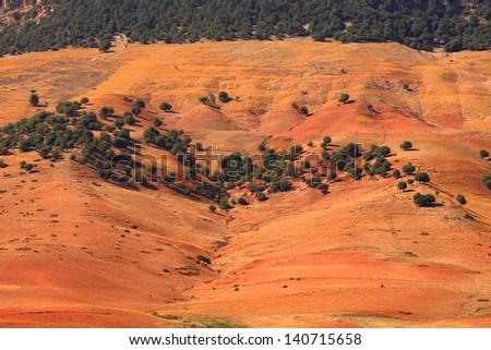 Eroded land near the Atlas mountains, Morocco - stock photo