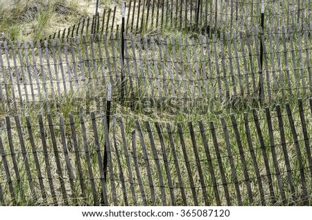 Erosion control at a glance: Sand fences on the slope of a dune by the shore of southeastern Lake Michigan, for themes of conservation and the environment - stock photo