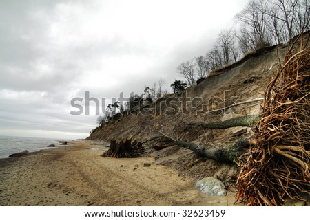 erosion of Baltic coast due to the storms and climate change - stock photo