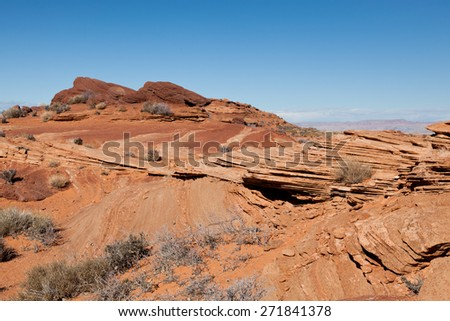 Erosion of sandstone rocks showing various layers and colors in the desert of Arizona near Glen Canyon. - stock photo