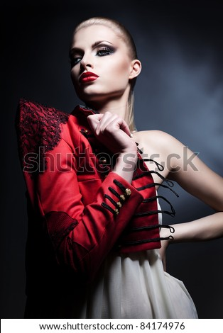 erotic beautiful blonde woman in red and white dress with red lips - stock photo