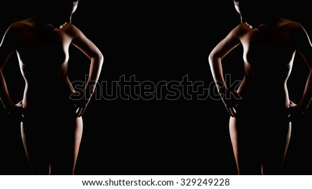 Erotic contour of a beautiful nude woman, her private parts are not visible, copy space in the center of the image, ratio 16:9 - stock photo
