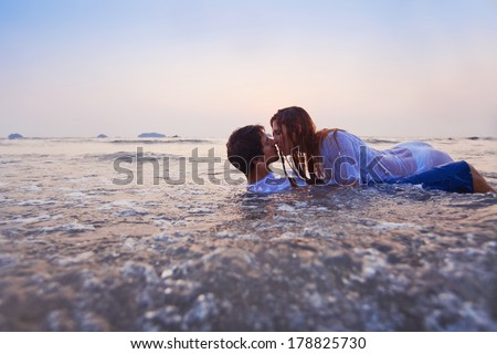 erotic couple kissing in the water - stock photo