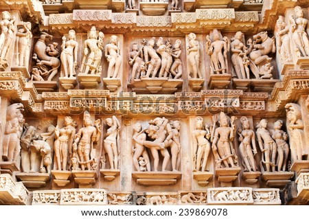 Erotic Human Sculptures at Vishvanatha Temple, Western temples of Khajuraho, Madhya Pradesh, India. Built around 1050, Khajuraho is UNESCO World heritage site and is tourist destination for erotica. - stock photo