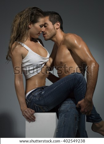 erotic scene of a sexy couple in jeans having sex - stock photo