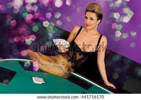 Erotic sexy passion young woman in lingerie model ready to play poker cards in casino - stock photo
