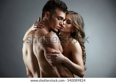 Erotica. Embrace of attractive nude couple - stock photo