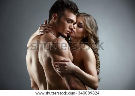 Erotica. Embrace of attractive nude couple - stock photo