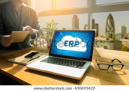 ERP as Emergency Response Procedures Thoughtful male person looking to the digital tablet screen, laptop screen,Silhouette and filter sun - stock photo