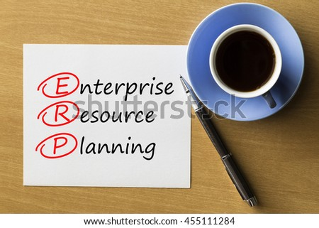 ERP Enterprise resource planning - handwriting on paper with cup of coffee and pen, acronym business concept   - stock photo