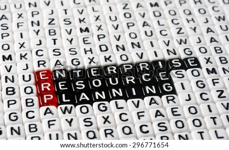 ERP Enterprise Resource Planning writen on black and white dices - stock photo