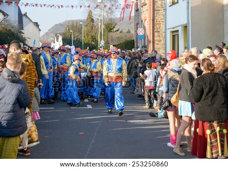 ERPEL, GERMANY 15 FEBRUARY 2015 - Unidentified persons celebrating a carnival procession to celebrate the end of Karneval season, an annual event held throughout certain regions in Germany