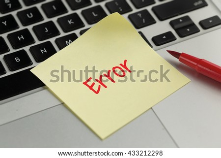 Error sticky note pasted on the keyboard - stock photo