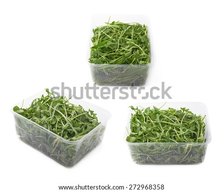 Eruca sativa rucola arugula fresh green rocket salad leaves in a plastic package box, isolated over the white background, set of three different foreshortenings - stock photo