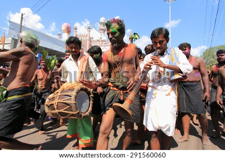 ERUMELI, INDIA - JAN 12 : Devotees sing and dance in the Petta Thullal procession on January 12, 2012 in Erumeli, India. Petta Thullal is a mass frenzied dance performed by devotees of Lord Ayyappa.