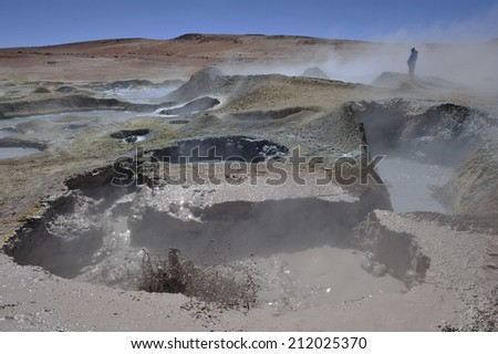 erupting geyser and steam, Altiplano high plateau at Andes Mountains, Bolivia - stock photo