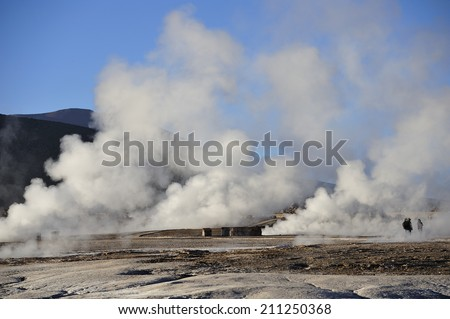 erupting geyser and steam, Atacama Desert, Chile - stock photo