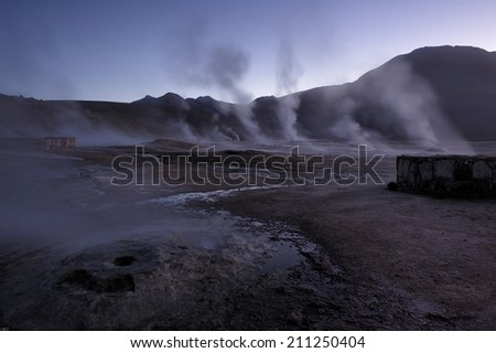 erupting geyser at sunrise, Atacama Desert, Chile - stock photo