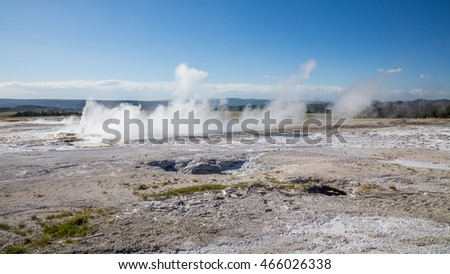 Erupting geyser with steam. Amazing landscape of the park. Fountain Paint Pots. Yellowstone National Park, Wyoming