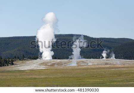 Erupting geysers with steam. Fountain Paint Pots. Yellowstone National Park, Wyoming