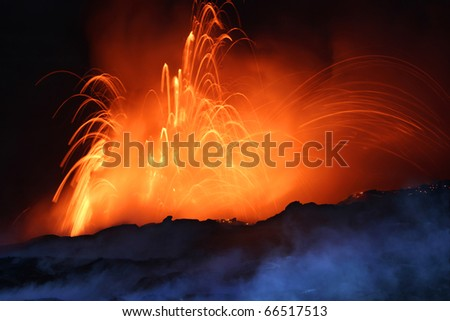 Erupting Volcano at Night - stock photo
