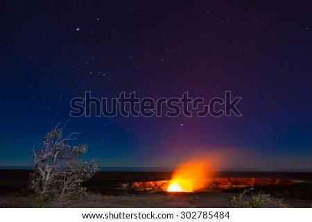 Erupting volcano in Hawaii Volcanoes National Park, Big Island, Hawaii. Night photos with long exposure. - stock photo