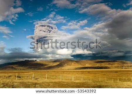 erupting volcano spreading ash in iceland - stock photo