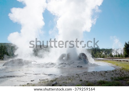 Eruption Grotto Geyser is a fountain-type geyser located in the Upper Geyser Basin in Yellowstone National Park in the United States - stock photo