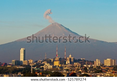 Eruption of Popocatepetl Volcano over the town of Puebla, Mexico