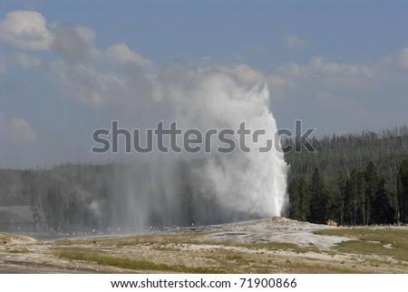 Eruption of the Old faithful geyser - stock photo